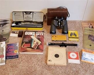 Lot of Empire 10x50 Binoculars, Outers Gun Cleaning Kit, Tasco 4x15 Gun Scope, Gun Books and Targets