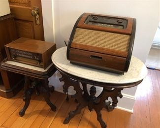 Altek radio on left and Phillips radio/record player on two marble top side tables.