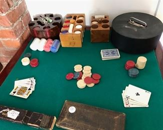 Vintage and plastic poker chips, slide rule and drafting tools.