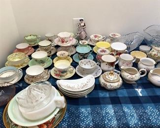 antique tea cups and assorted vintage crystal serving bowls.