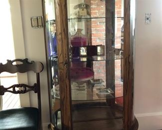 Display cabinet, if you take a closer look you will find tintypes, Versace trinket plate and other treasures.
