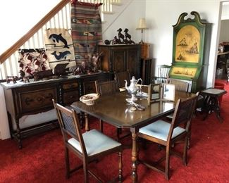 Vintage dining room set, Mexican hangings, MCM desk with bookshelves behind the closed door at the top.