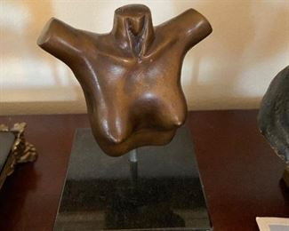 modern bronze and stone female torso by W. Connell asking $80
