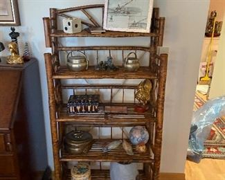 a second bamboo shelf for sale filled with collectibles