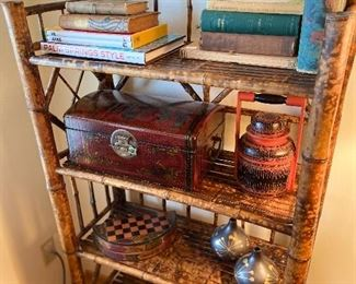 Vintage and antique collectible books,  with asian antique collectibles on display.