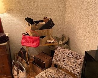 boudoir chair along with designer handbags