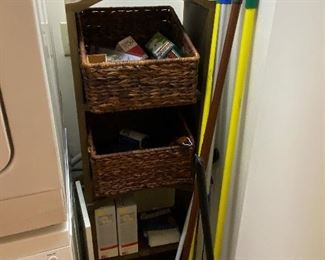 household cleaning tools and shelving unit