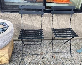 pair of folding black metal outdoor chairs