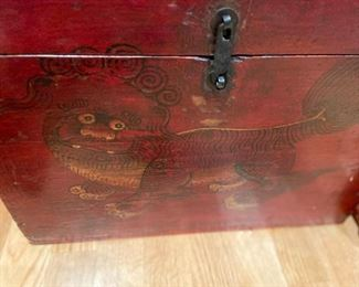 closer view of the face of the box painted with Foo Dog on the front