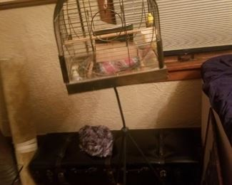 Vintage 1950's bird house with original items inside cage.