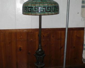"""Gorgeous bronze Atlas floor lamp with 3 nude males at base holding a star covered 1/2 globe ISO Franz Metzner with a 26"""" diameter leaded art glass Greek Key pattern shade"""