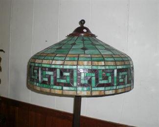 detail of leaded art glass Greek Key pattern shade on Atlas bronze floor lamp