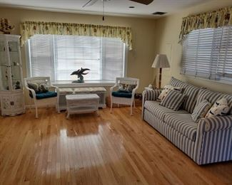 white wicker, sleep sofa, chairs and curio