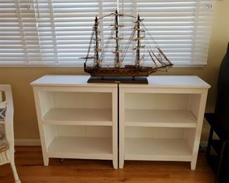 2 book cases or storage cases, these come with wicker bins that fit inside