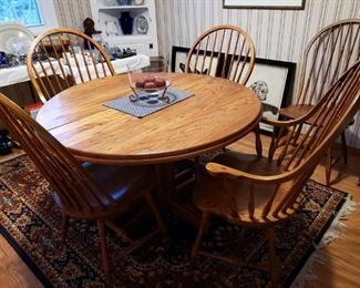 Oak pedestal dining table with 6 chairs