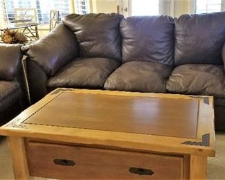 #3 - Dark brown Leather Sofa - $350. Lift top table with storage $195