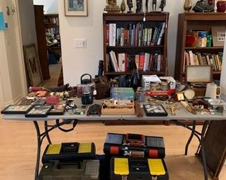 books, military items, bookcases and objects form world travels