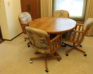 Solid Oak Dining Table with Upholstered Chairs ( on wheels) New Condition