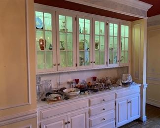 Dining room cabinets display a wealth of treasures