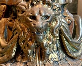 Closeup of lion on fireplace fender.