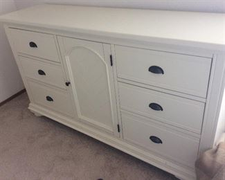 Super clean six drawer dresser. The center has shelves for pants, sweaters, etc.  The drawers smell fresh and slide easily