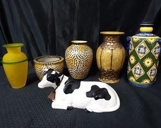 5 vases, 1 cow