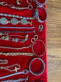 Gold and silver bracelets, earrings, charms, and rings