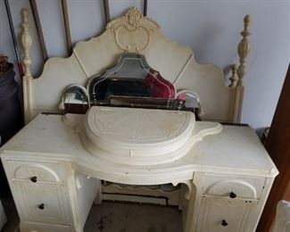 Beautiful Art Deco Full size bed frame with matching dresser with mirror.