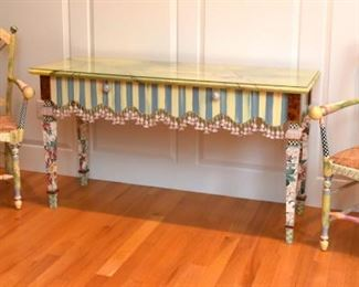 MacKenzie-Childs console table with custom glass top; MacKenzie-Childs chairs