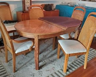 Dining table with 6 chairs and pad