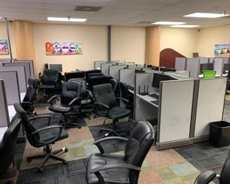 Pic of cubicles and chairs while still set up in old office location.