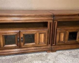 Two matching entertainment cabinets with storage for DVD's underneath. Can be sold together or separately.
