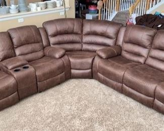 Two month old 4 recliner sectional from Furniture Row. Has storage and cup holders.