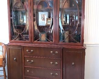 Stunning, Mahogany Bookcase, drawer opens up to become a desk.  Oval Bubbled glass doors were very expensive to make.  This is a special piece.  It can also be used as a China Cabinet