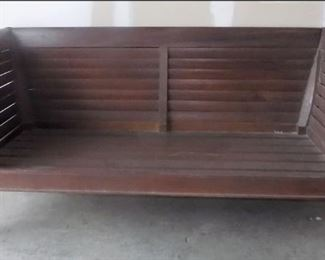This is the sofa that goes with the teak armchairs.  We have the cushions for it, but opted to show the detail.  It will not fit through the door to be present at the sale.  It is in another warehouse not far away.