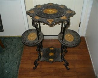 A spectacular 19th century cast iron plant stand with gold gilding