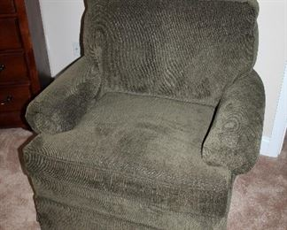 Comfy green upholstered swivel chair