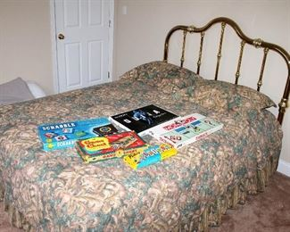 Queen bed with brass headboard
