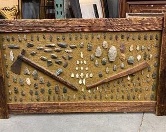 Assemblage of American Indian artifacts including tomahawk, and stone arrow heads