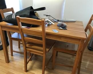 """IKEA table with 4 chairs measures 46.5""""x29"""""""