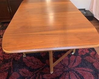 Unique Mid-Century Modern drop leaf table with under compartment storage for 4 chairs
