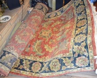 "5'6"" x 8'6"" hand knotted wool rug from India $650"