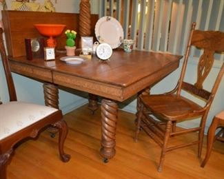 oak pub table, spiral legs, center leg & leaf $225