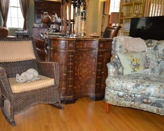 antique wicker rocker $125; cellarette $65; upholstered chair$75