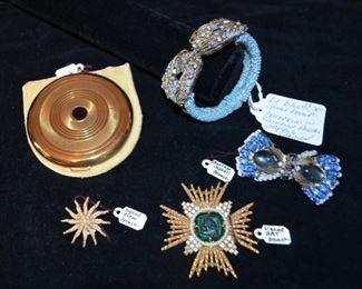 "Vintage New York Coty compact; Mariam Haskell light blue faceted hinge bracelet w/ hand sewn seeded Austrian crystals $275, signed ""Cinor"" brooch; signed ""Art"" brooch; signed ""Mariam Haskek"" blue brooch$175."