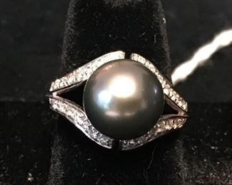 14k gold Black pearl ring surrounded by diamonds.  Size 6.5.  Total weight 6.7g. $750,