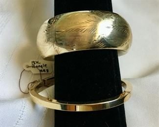 Top:14k gold hollow hinged bangle 34.5g $2,800. (2015 Appraisal $3,400) Bottom: 18k yellow gold plain polished bracelet 9.79g with fold over safety lock $650 (2015 appraisal $1,575.)