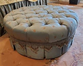 Button tufted ottoman matches bedroom