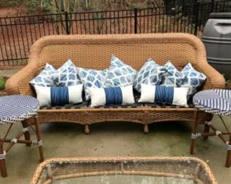 Assorted outdoor pillows and side tables