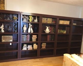 There are six sections of this wood bookcase